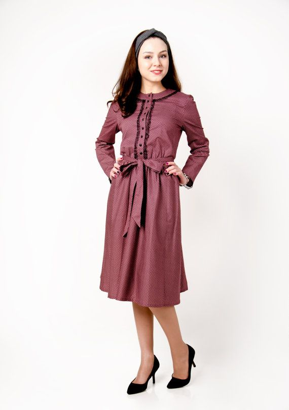 Romantic dress , created from quality fabric. Very comfortable variant for autumn holiday or any otreg occasion look of every fashionista. Loose silhouette. Color: bordo with small rattern Fastener with buttons. Rubber band on the waist. Decorated with black lace. Fittet silhouette. A-line skirt. Goes with belt of the same material as a dress. Deep pocket, into which fits your phone. Dress length - 106 cm. Sleeves length - 60 cm.  FABRIC: viscose - 50% polyester-50%  CARE: Delicate Machine…