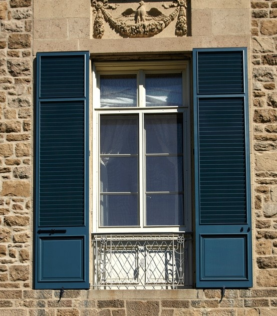 Custom configuration panel and louvered style and custom for Spanish style window shutters