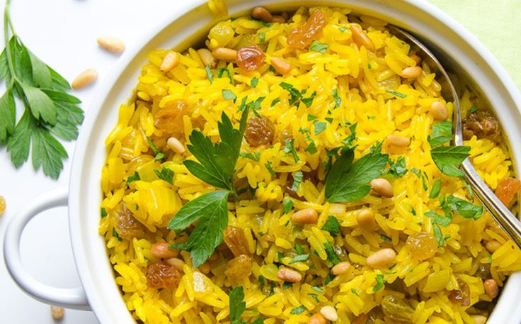Jeweled Yellow Rice With Pignoli Nuts and Golden Raisins [Vegan] | One Green Planet