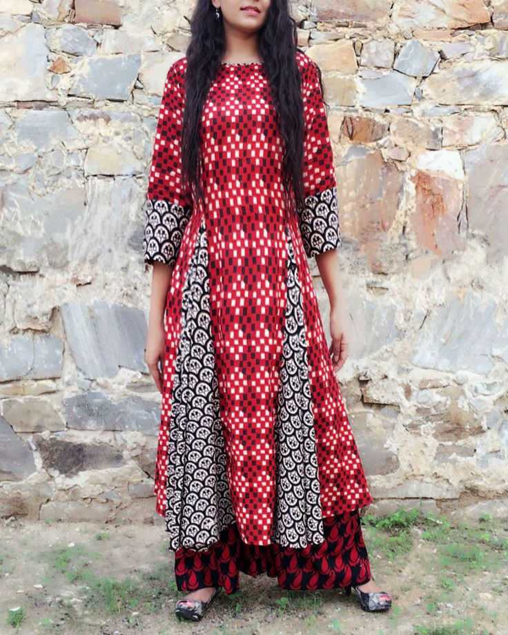 Multi flared black and white hand block print red ikat kurta. It has boat neck and three forth sleeves. It comes along with black palazzos with red paisley print
