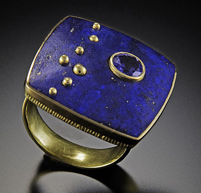 Jeff and Susan Wise  |  Stargazer - Ring with 18k gold spheres. Bezel set faceted purple/blue saphire.