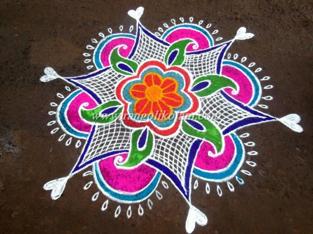 Free hand style kolam with wonderful colour combination for Floor rangoli design