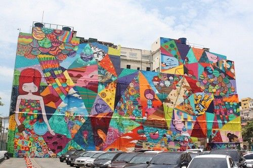 A giant and colorful mural is bringing a bit of life to Rio de Janeiro's poor port region. The area is being renewed for the 2016 Olympic Games.  The vibrant artwork is courtesy of Brazilian graffiti artist Toz  (Tomaz Viana) who, together with his friends, is filling the 98-foot tall mural with bright colors and random caricatures.