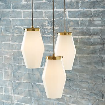 "Mid-Century Glass Pendant #westelm  15""diam. x 32""h. Adjustable height. Metal frame in plated Antique Brass finish. Three white opal glass pendants. Gray cloth-wrapped cords. Hardwired; professional installation recommended. Imported."