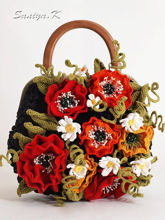 The crochet handbag is made in an interesting technique of free-form: a plurality of separate related items to collect for solid foundation. Poppies, stems of flowers can be modeled: inside a metal wire. Closure with locking frame with a wooden handle, inside lining with pockets: on the lightning, open and mobile. Bag dense, perfectly holds form.  Dimensions (without handles) 28 (width) x 24 (height) x 8 (thickness) cm.