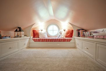This was an attic space made into a playroom with a built-in day bed and built-in drawers for all those toys!