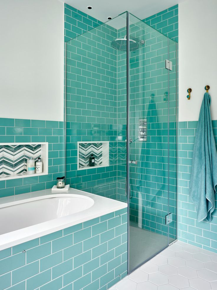 frameless glass shower with turquoise subway tile