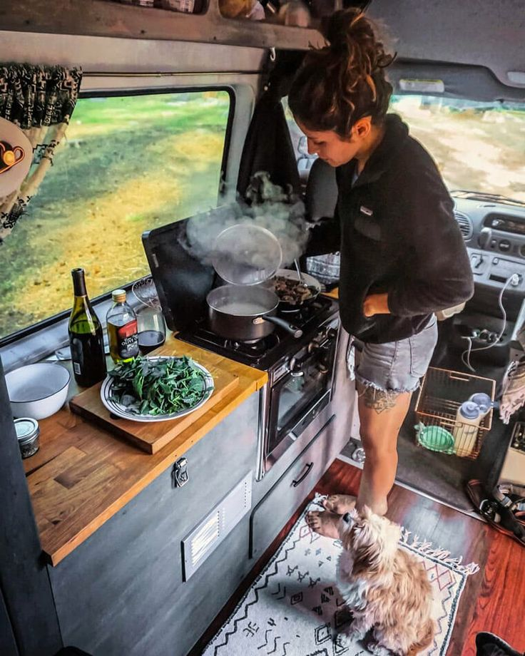 This is one of the best DIY kitchen layout designs I have seen in a camper conversion! I love the the storage and organization. Great ideas and tips for cooking food in a van as well as hacks to build a camper for #vanlife