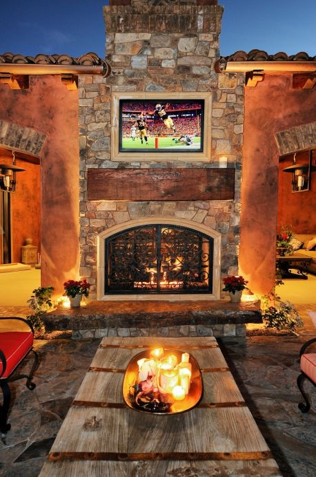 Lovely see-through outdoor fireplace opens also into Family Room, which has glass doors that slide into wall pockets...♥ ♥ ♥