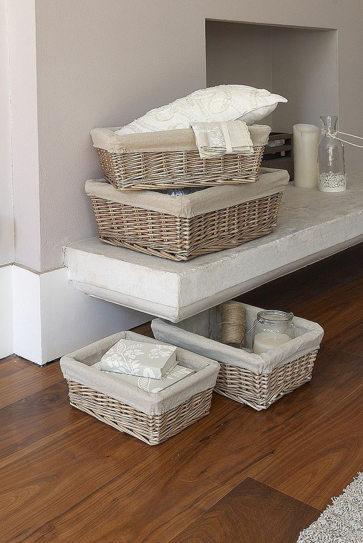 Five sizes of hand woven tapered wicker baskets fitted with removable calico liners.