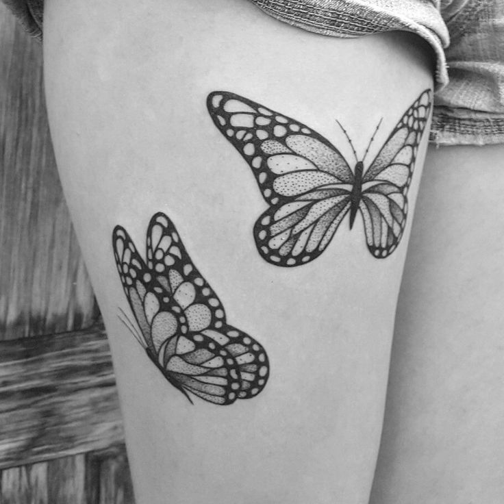black and white illustration butterfly thigh tattoo