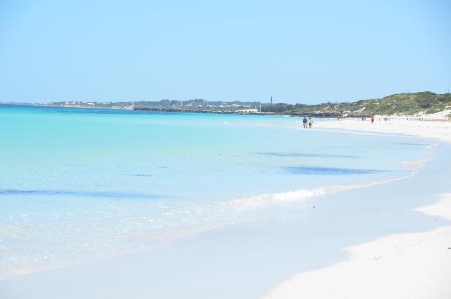 Mullaloo Beach, Perth, Western Australia. White powdery sand and no waves. Watch the stingers, though.