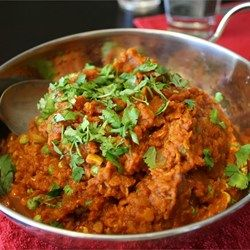 This is an easy recipe for Chicken Tikka Masala - Chicken marinated in yogurt and spices and then served in a tomato cream sauce.