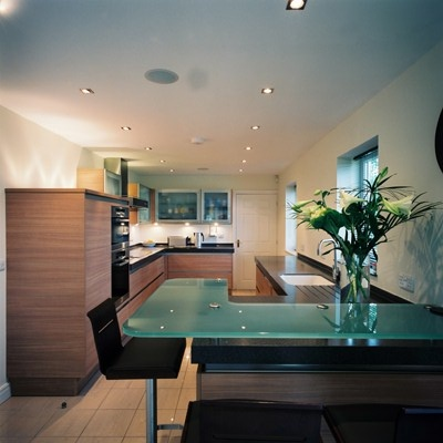 The use of frosted glass on the breakfast bar and wall for Galley kitchen with breakfast bar