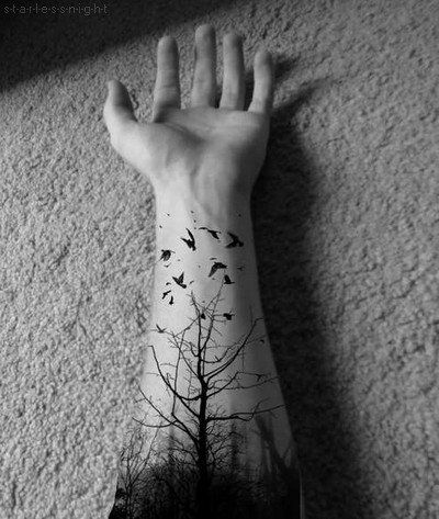 Tree & birds tattoo.