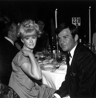 American actor Connie Stevens and her first husband, American actor James Stacy, sit at their table at the Screen Producer's Ball.