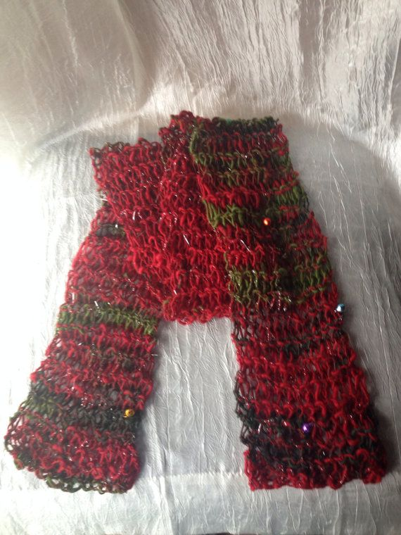 Gorgeous cowl/scarf in luxury art yarn hand spun hand by WoolnLove this yarn was spun by WeirdAndTwisted on etsy, it has tinsel, and little bells spun in and makes a tinkling sound when you wear it
