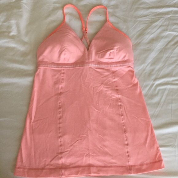 Lululemon pink strappy top Lululemon pink strappy top. Includes removable padding and adjustable straps. No signs of wear, in perfect condition! lululemon athletica Tops Tank Tops