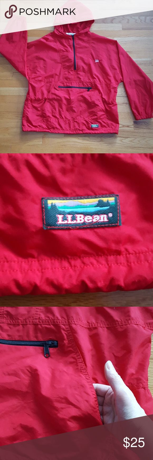L.L.Bean nylon half zip windbreaker with hood. L.L.Bean nylon half-zip windbreaker with hood and drawstring Hood drawstring at the waist and drawstring at the bottom for maximum control. Has zipper pouch and full pocket across the front. Clean and no odors. LL Bean Jackets & Coats