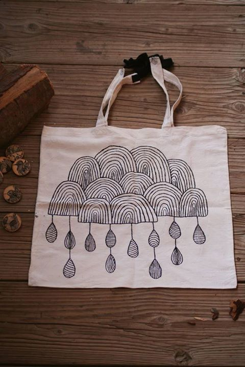 Hand-painted recycled canvas tote bag with cloud pattern.