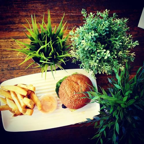 """""""Bird 'n Brie"""" burger from Grill'd Burgers... and a couple of little plants to add that 'healthy' touch."""