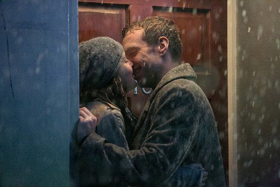 Nat and Josh, I Give It a Year: Rose Byrne and Rafe Spall give us a classic rain-soaked movie kiss. Source: Magnolia Pictures