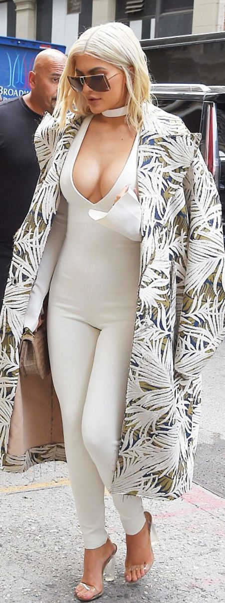 Kylie Jenner: coat – Off____White  Jumpsuit – Laquan Smith  Shoes – Yeezy  Purse – M2Malletier  Sunglasses – Ferrari