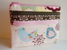 Alternate finishing tutorial for triple zip pouch @  http://aquilterstable.blogspot.com/2012/08/triple-zip-pouch-tutorial.html