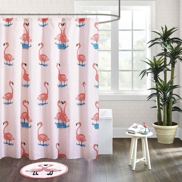 The HipStyle Rosie shower curtain adds color and fun to your space with its printed chevron and flamingos in bold pink on a textured cotton fabric.