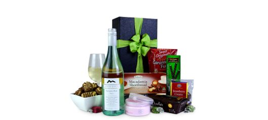 With everything she could desire, wine, body butter, chocolates, lollies, fudge, truffles, shortbread and plenty more, this is the perfect gift basket for her!  #giftsforher #giftbaskets