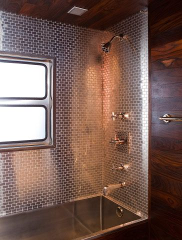 The bathroom features steel tiles from Ann Sacks and, left, hardware by Antonio Citterio for Hansgrohe.: Showers, Shower Tubs, Vintage Trailers, Tile Shower, Airstream Bathroom, Caravan Interiors, Travel Trailers, Stainless Steel, Vintage Campers