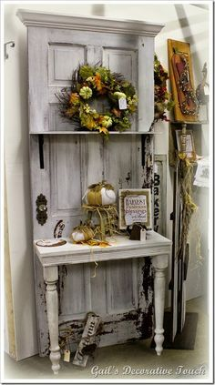 repurpose an old door into a potting bench. I have seen this done with old screen doors too.