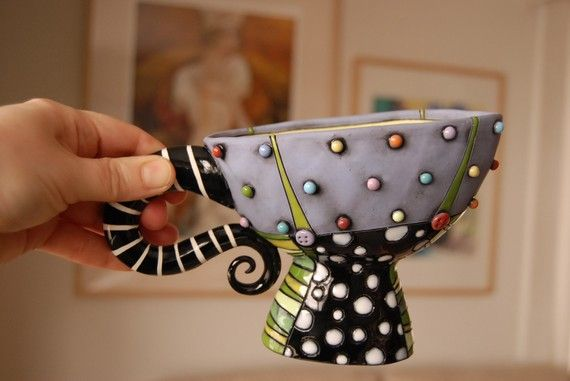 I've loved this cup since the first time I saw it...  I think I might have to have an Alice in Wonderland shelf somewhere...  :-)