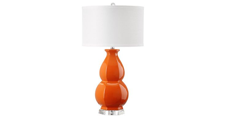 A classic double gourd form on this table lamp gets a fashion update with faceted detailing in bright orange glazed ceramic. This striking transitional lamp is finished with a textured white cotton...
