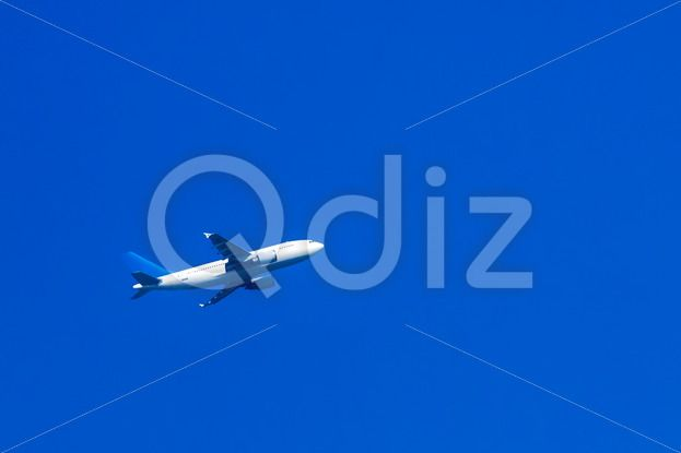 Qdiz Stock Photos | Jet airplane in sky,  #air #airbus #airplane #background #blank #blue #bright #brightlylit #business #businesstravel #clearsky #cockpit #day #flight #flying #jet #Journey #large #plane #sky #sunlight #tourism #tourist #transport #transportation #Travel #unbranded #white #wing