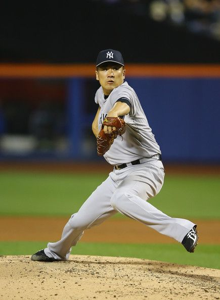 Masahiro Tanaka #19 of the New York Yankees pitches against the New York Mets during their game on May 14, 2014 at Citi Field in the Flushin...