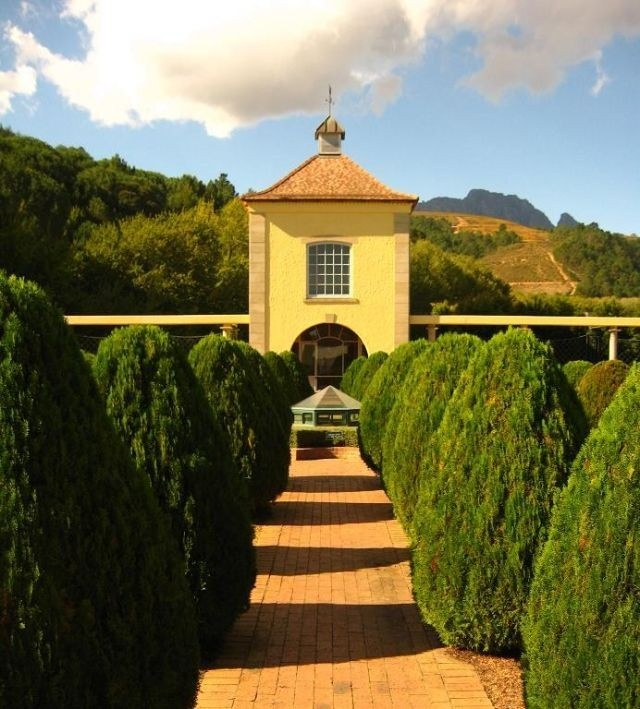 The illustrious Morgenhof Wine Estate is situated on the slopes of the Simonsberg mountains outside Stellenbosch, dates back to 1692.   Stellenbosch, South Africa.  Go to www.YourTravelVideos.com or just click on photo for home videos and much more on sites like this.