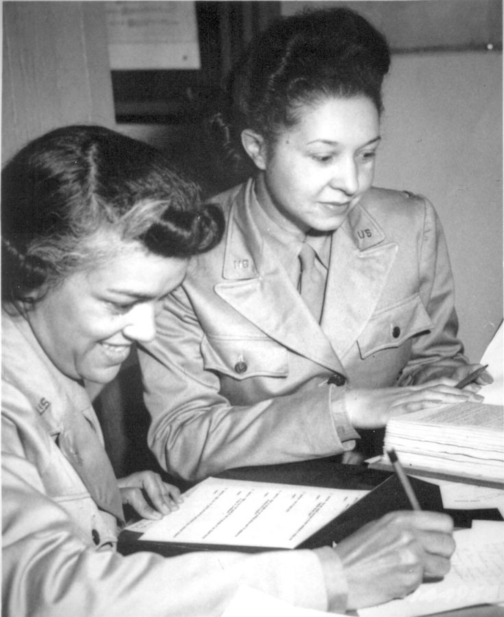 WAACs at work in Temp. Bldg. `M', Washington, DC, WAAC Headquarters. Left to right: Lts. Harriet West and Irma Cayton. 1942.Wilfred Morgan.