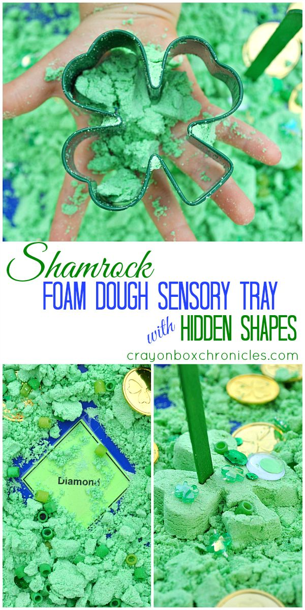 Shamrock Foam Dough Sensory Tray with Hidden Shapes by Crayon Box Chronicles. Invitation to play and create explores sensory, tracing, shape recognition, and loose materials.