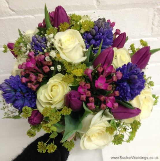 Spring Mix Pinks Purples and Blues Bridal Bouquet with Ivory rose, purple tulips, blue hyacinth, gypsy grass, pink bouvardia  Wedding Flowers Liverpool, Merseyside, Bridal Florist, Booker Flowers and Gifts, Booker Weddings