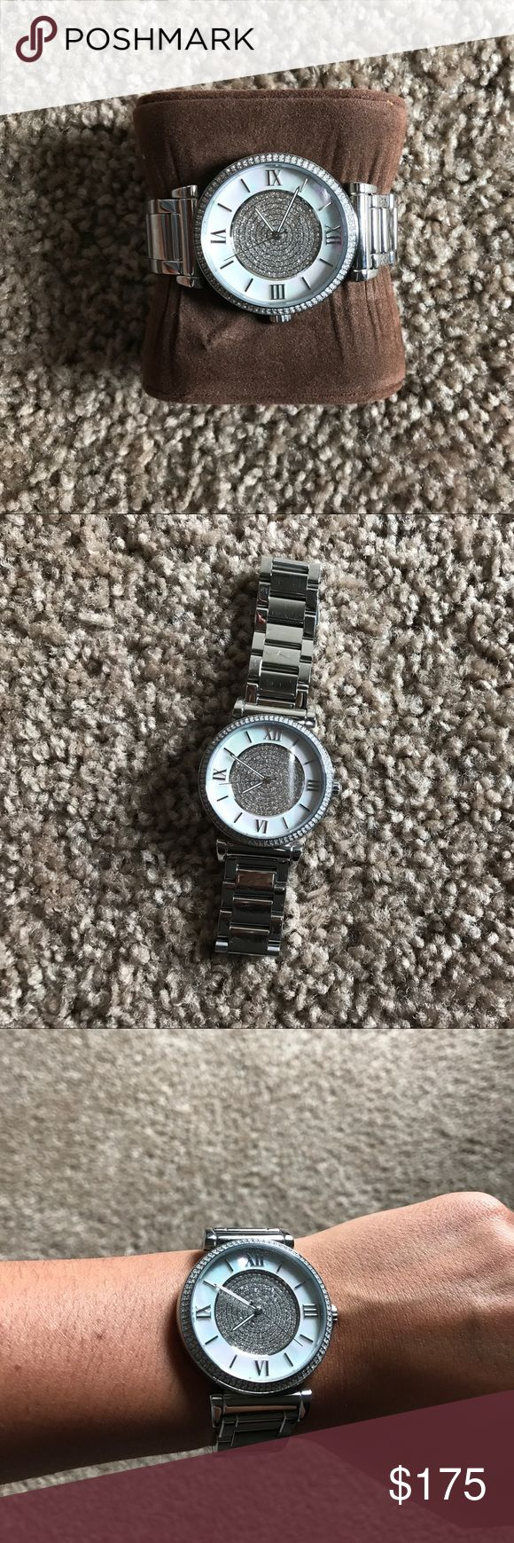Michael Kors Silver Watch Selling a Michael Kors watch, only worn twice! The item is in pristine condition and is a beautiful accessory. Michael Kors Accessories Watches