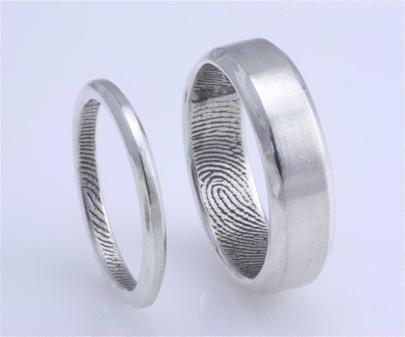 25mm/6mm Set Sterling Silver Custom Fingerprint by fabuluster, $475.00    I think this would be cute in regards to the wedding ring for the girl and a wedding band for the guy. Since it is a simple pattern it would attach with anything just perfectly!