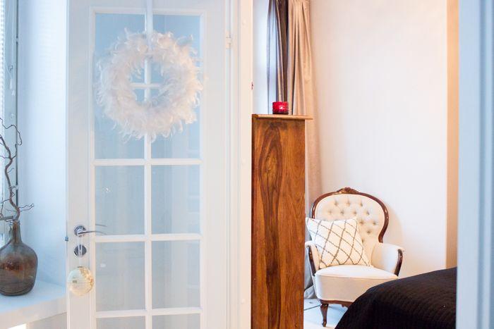 Linen upholstered antique armchair, red candle holder / www.livinupanotch.com