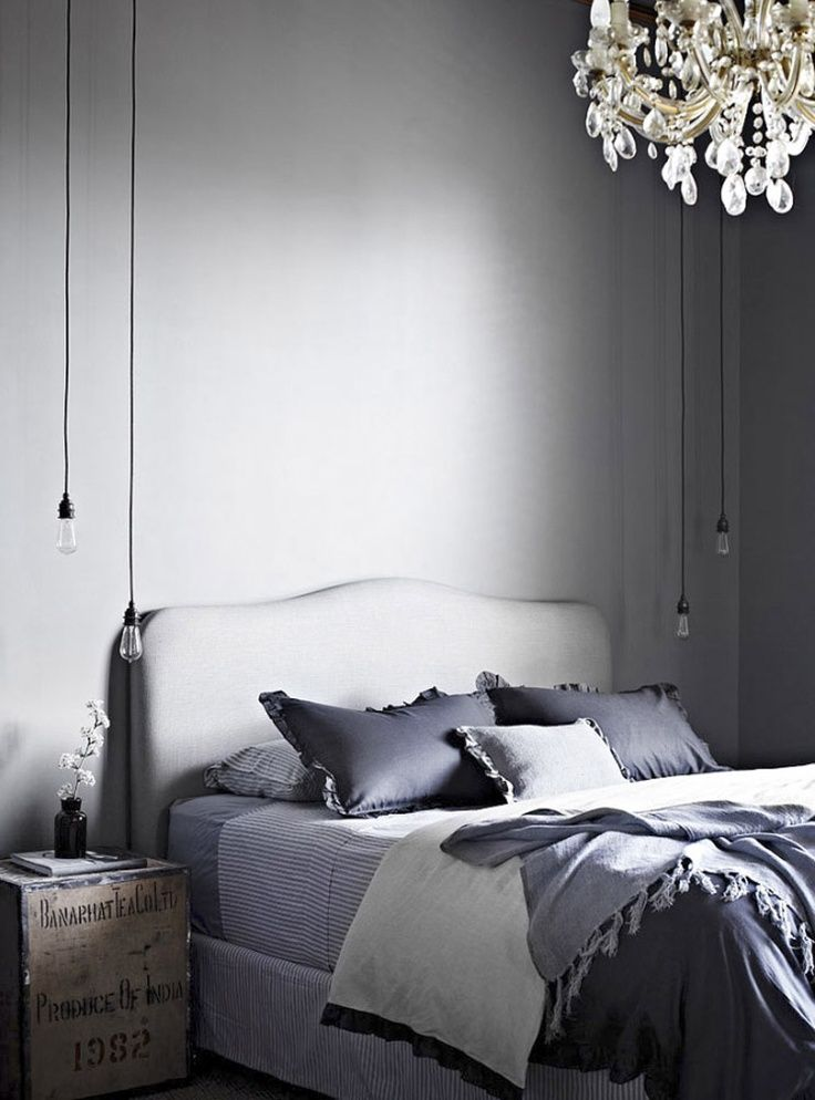 unique lighting in this master bedroom for the home