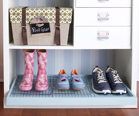 Organization Ideas: Dry shoes on metal cooling racks places in trays.