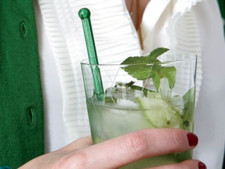 "The mojito may be Cuba's national cocktail. The drink gets its name from the African word mojo, which means ""to cast a spell."" Making mojitos in a pitcher doesn't work -- it's impossible to distribute the lime and mint evenly, plus the club soda tends to turn flat. Instead, muddle a large batch of mint, limes and sugar, then pour the mixture into glasses and top with ice, rum and club soda."