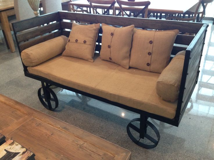 How cool is this train cart sofa in reclaimed metal and wood ? www.nestinghabits.ca