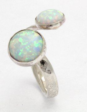 sterling silver hammered ring set with 6 and 8mm white opal stones. Handmade in the UK by Lavan Jewellery.