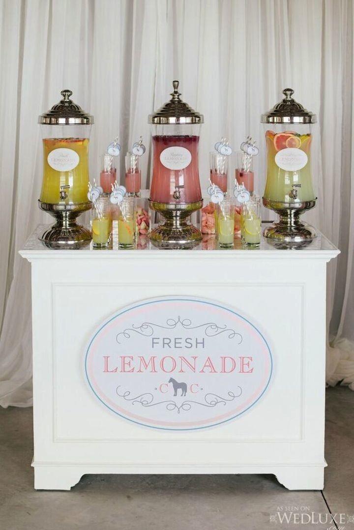 photo: Mango Studios; Via wedluxe; Wedding cocktail hour lemonade bar idea;