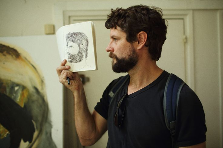 Ben holds a portrait drawn by his son, Joe. Australian artist, Ben Quilty in Paris during a three month period in which time he had the use of a studio - granted through residency program - in Montematre, Paris. Photo: Andrew Quilty / Oculi